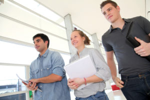 Group of students walking in school hallway